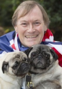 Sir David Amess with two dogs